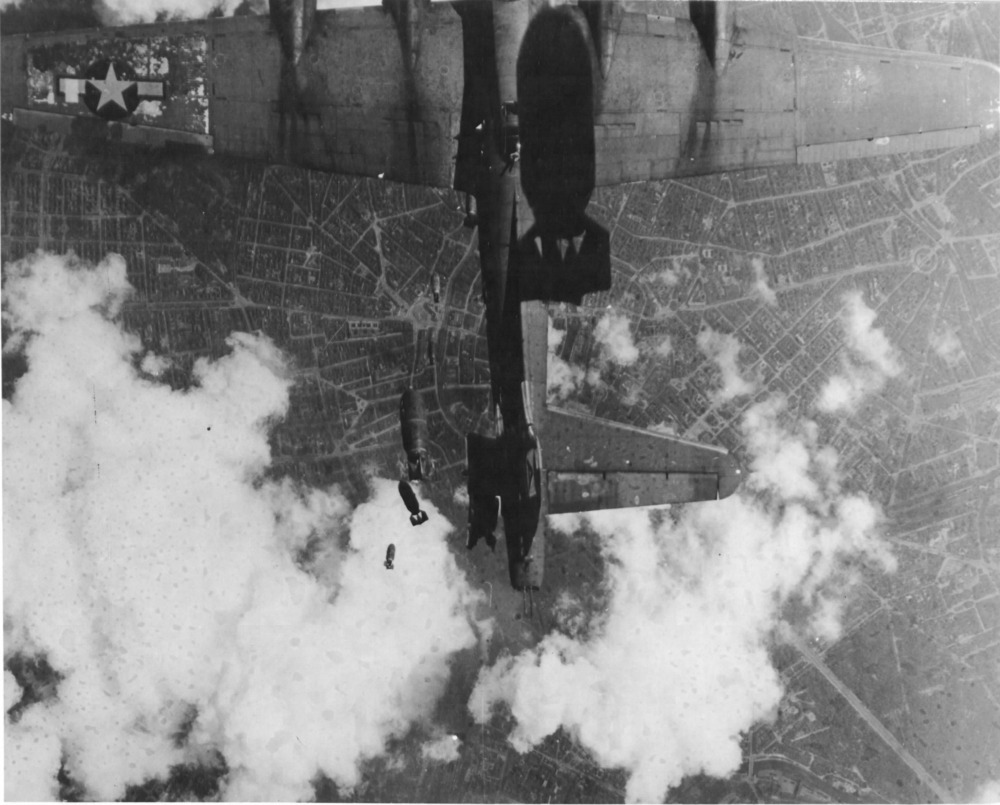 "B-17G Flying Fortress ""Miss Donna Mae II"" drifting under another bomber over Berlin, 19 May 1944 (US National Archives)"