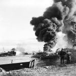 Sailors fighting fires on USS LST-480 resulting from explosion of LST-353 the previous day, Pearl Harbor, Territory of Hawaii, 22 May 1944 (US National Archives)
