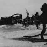 Men of 163rd Infantry Regiment hit the beach from Higgins boats during the invasion of Wakde Island, New Guinea, 18 May 1944 (US National Archives)