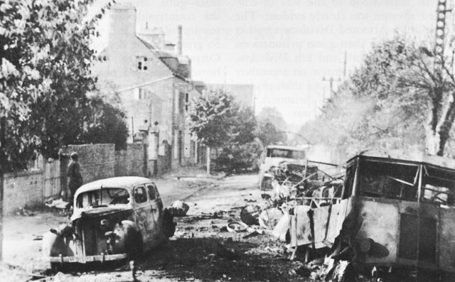 Destroyed German vehicles in Avranches, France, July 1944. (US Army Center of Military History)