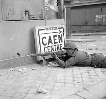 British soldier in Caen, France, 9 July 1944 (Imperial War Museum)