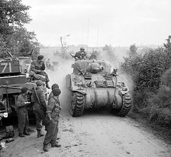 British Sherman tanks in the assault on Caen, France, 8 July 1944 (Imperial War Museum: 4700-29 B 6642)