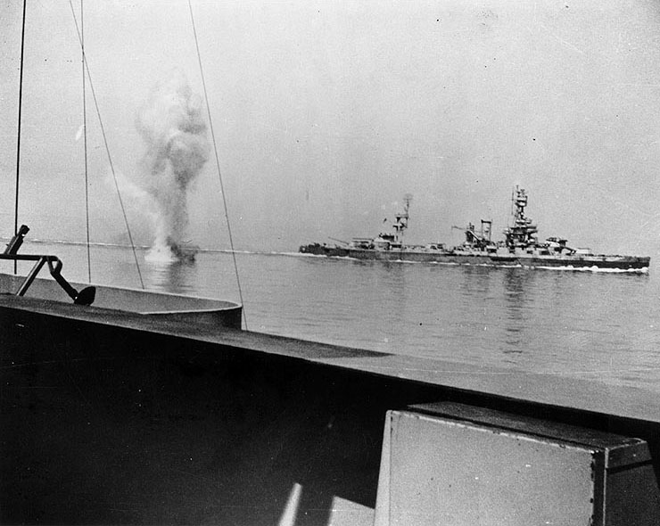 German coast artillery shell falling between battleships USS Texas (background) and USS Arkansas (foreground) off Cherbourg, France, 25 June 1944 (US National Archives)