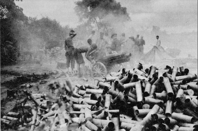 US 75-mm howitzer crew firing at Japanese positions in Myitkyina, Burma, June 1944 (US Army Center of Military History)
