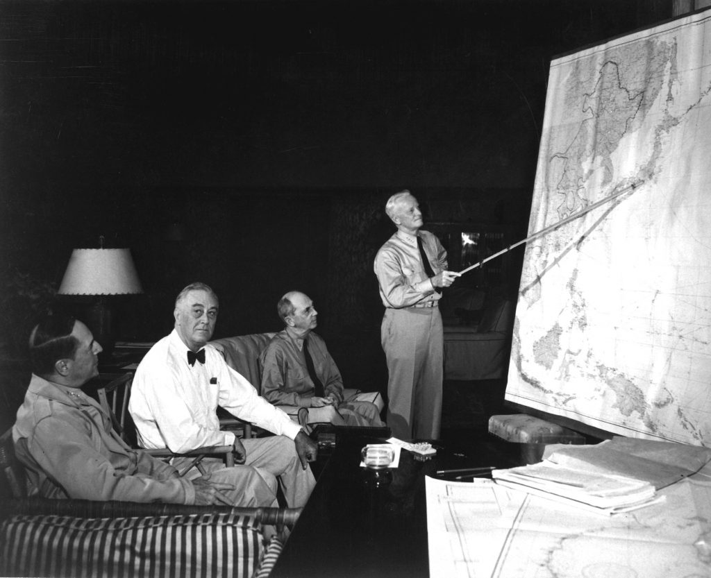 Pres. Franklin Roosevelt in conference with Gen. Douglas MacArthur, Adm. Chester Nimitz, and Adm. William Leahy, Hawaii, July 1944. (US Navy photo)
