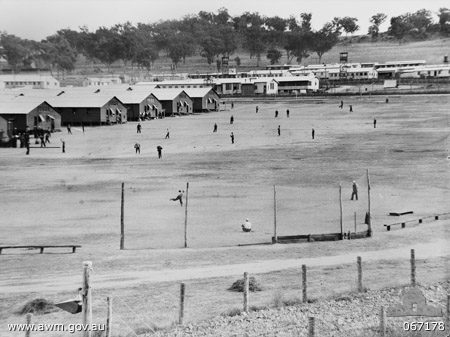 Japanese prisoners of war practicing baseball at No.12 Prisoner of War compound near Cowra, NSW, Australia, 1 Jul 1944 (Australian War Memorial: 067168)