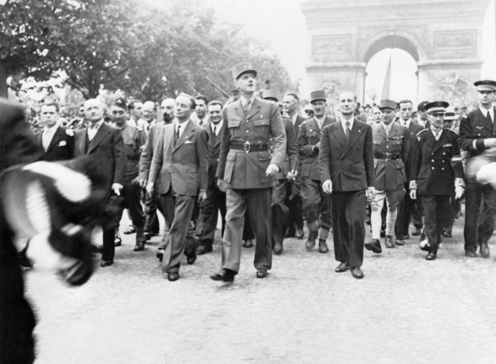 Gen. Charles de Gaulle and his entourage at the Arc de Triomphe, Paris, 26 Aug 1944 (Imperial War Museum: HU 66477)