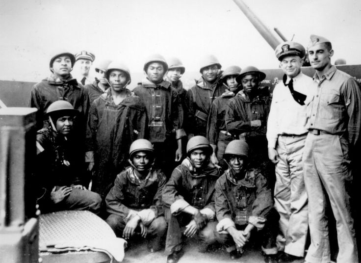 African-American mess attendants/gunners and white officers aboard cruiser USS Indianapolis, 10 July 1942 (US National Archives)