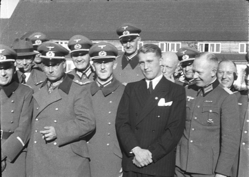 Wernher von Braun (in civilian clothes) with German officers at Peenemünde, Germany, 21 March 1941 (German Federal Archives: Bild 146-1978-Anh.024-03)