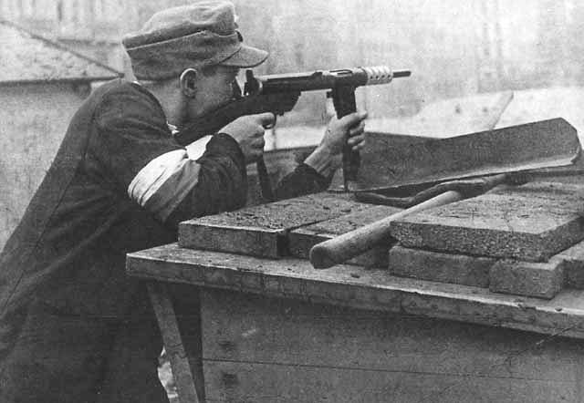 Polish resistance fighter during the Warsaw Uprising, Aug 1944 (public domain via WW2 Database)