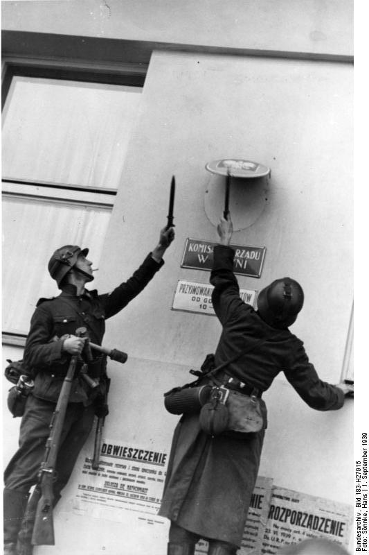 German troops removing the Polish emblem from the wall of a post office in Danzig, 1 Sep 1939 (German Federal Archive, Bild 183-H27915, Photographer: Hans Sönnke)