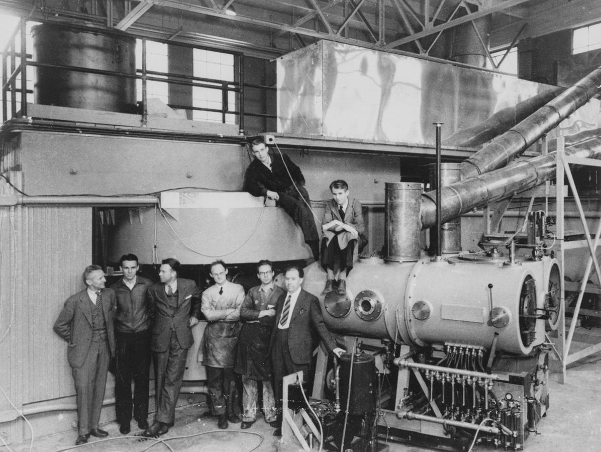 Cyclotron at the Lawrence Radiation Laboratory, Berkeley, CA in 1939; the key figures in its development and use are shown, left to right: Dr D Cooksey, Dr D Corson, Dr Ernest Lawrence, the inventor of the cyclotron; Dr R Thornton, Dr J Backus, WS Sainsbury, Dr LW Alvarez, and Dr Edwin Mattison McMillan (Science Museum London)