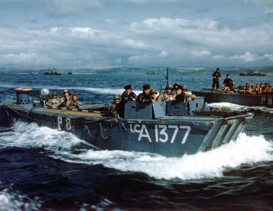 British Navy Landing Craft LCA-1377 carries US 5th Rangers to transport HMS Baudouin, Weymouth, England, June 1, 1944. Rangers include Lt. Stan Askin, Capt. John Raaen, Maj. Richard Sullivan, and chaplain Father Lacy, carrying medical supplies. British sailors in the conning tower (US National Archives)