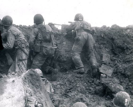 One of the very few pictures showing the US 2nd Ranger Battalion in action on D-day inside a crater on Pointe du Hoc (US Navy photo)