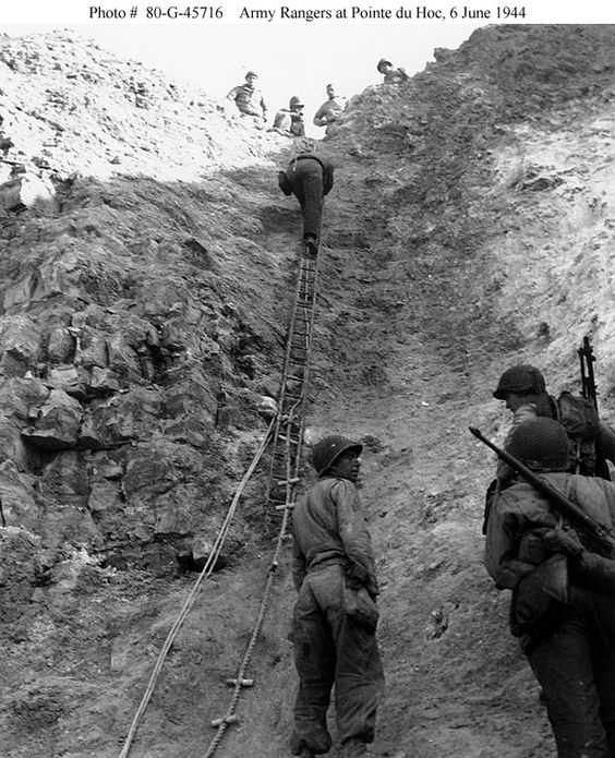 Rangers climbing the cliff of Pointe du Hoc on D+2 (June 8, 1944), bringing up supplies. A ladder, a toggle rope, and two plain ropes are in view ((US Navy photo #80-G-45716)