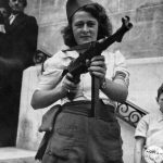 French resistance fighter Simone Segouin (nom de guerre Nicole Minet) posing with a MP 40 submachine gun in Paris, 23 Aug 1944 (US Army Signal Corps photo)
