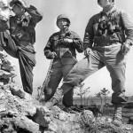 Lt. Gen. Simon Buckner, Jr., Maj. Gen. Lemuel Shepperd, and Brig. Gen. William Clement on Okinawa, 22 May 1945 (US Marine Corps photo)
