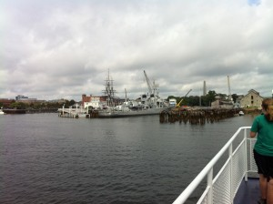 View of the Charlestown Navy Yard from the ferry, USS Cassin Young in the foreground, USS Constitution in the background. (Photo: Sarah Sundin, July 2014)