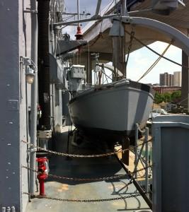 Whaleboat hanging on its davits, USS Joseph P. Kennedy, Jr., Battleship Cove, Fall River, MA, July 2014 (Photo: Sarah Sundin)