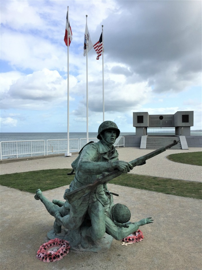 Statue Depicting An American Solr Saving A Wounded Buddy On Omaha Beach D Day