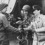 Flight nurses Lt. Suella Bernard and Lt. Foster, the first nurses to evacuate the wounded from Normandy to England. (US National Archives)